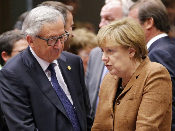 European Commission President Jean-Claude Juncker (L) and German Chancellor Angela Merkel (R) arrive at the start of an extraordinary EU Summit on the current migration and refugees crisis in Europe, in Brussels, Belgium, 23 September 2015. EU leaders meet for an extraordinary summit on migration, with also international aid for third countries and the border protection on their agenda.