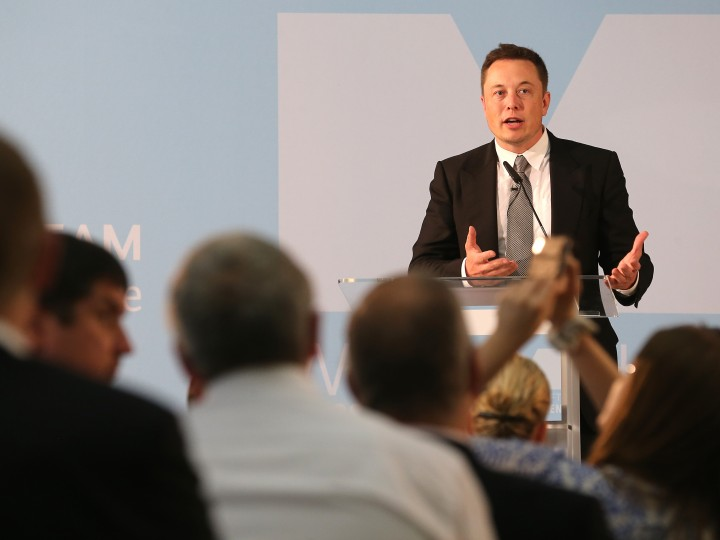 epa04946874 Tesla boss and internet entrepreneur Elon Musk speaking during a discussion event about the future of the economy at the German economy ministry in Berlin, Germany, 24 September 2015.  EPA/WOLFGANG KUMM
