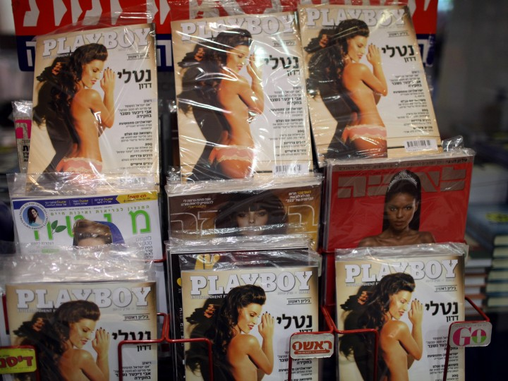 epa03612331 'Playboy' magazines are ready to be sold to customers at a street kiosk in Jerusalem, Israel, 06 March 2013. The international magzine for the first time this week has launched its first edition in Hebrew.  EPA/ABIR SULTAN