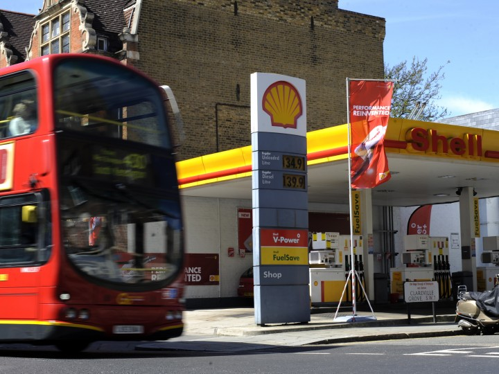 epa04026178 (FILE) A file photo dated 02 May 2013 showing a London bus passing a Shell service station in London, Britain. Shares in Shell fell by 4 per cent in London on 17 January 2014, after the energy giant warned that fourth quarter results would be 'significantly lower than recent levels of profitability.' Results in the final quarter of 2013 were expected to halve to 2.2 billion dollars, while whole year profits were estimated at 16.8 billion dollars, an almost 40-per-cent drop compared to 2012. Shell blamed the drop in profit on lower oil and gas prices, a weakening of the Australian dollar, higher exploration costs and lower volumes upstream, as well as a 'challenging' security situation in Nigeria.  EPA/FACUNDO ARRIZABALAGA