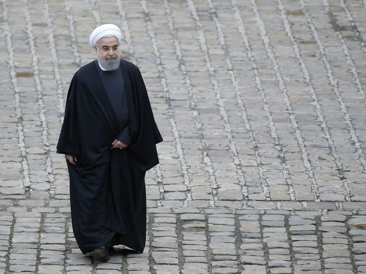 epa05130988 Iranian President Hassan Rouhani during a military parade at the Invalides in Paris, France, 28 January 2016. Rouhani's visit to Europe is the first by an Iranian president in sixteen years following the lifting of sanctions against his country.  EPA/YOAN VALAT