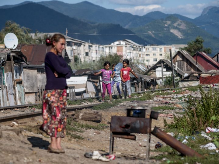 epa03863798 (07/16) Girls walk on railroad tracks next to huts while a woman is cooking in a slum inhabited by a Roma community in the Craica neighbourhood of Baia Mare, north-western Romania, 05 September 2013. This year the local government planned to demolish shanties of the Craica slum and move hundreds of residents to a new housing estate of 500 light structure, modular homes to be set up in the outskirts of Baia Mare.  EPA/ZSOLT CZEGLEDI HUNGARY OUT - PLEASE REFER TO ADVISORY NOTICE  (epa03863791) FOR FULL FEATURE TEXT
