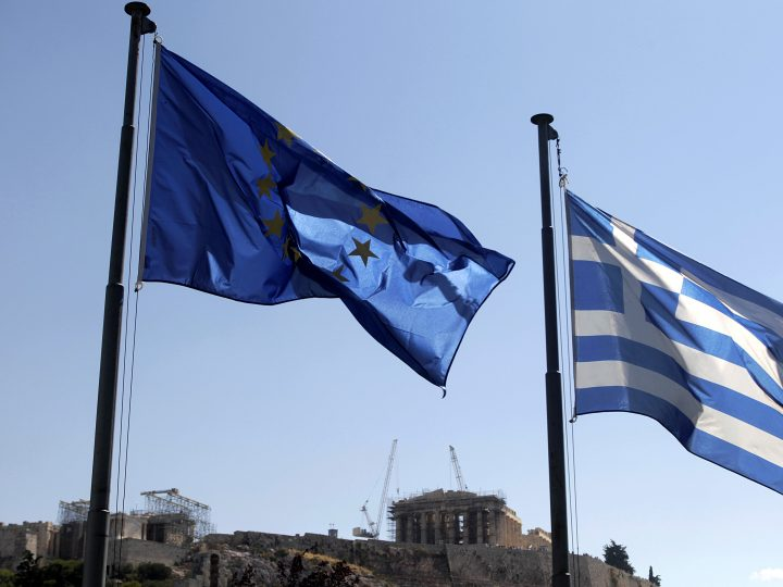 epa04834768 A Greek and a European Union flag flutter in front of the Acropolis hill in Athens, Greece, 07 July 2015. Eurozone member states on 07 July are waiting for the Greek proposals in order to discuss a new aid programme for Greece. Prime Minister Alexis Tsipras is heading to Brussels to participate in the summit. In the eurozone summit, that will also be attended by ECB president Mario Draghi and Eurogroup chief Jeroen Dijsselbloem, officials will discuss the actions to be taken after the referendum.  EPA/ORESTIS PANAGIOTOU