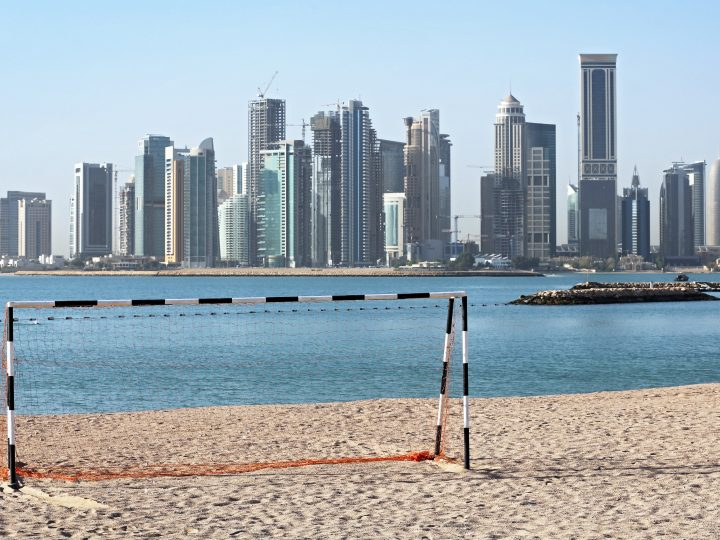 epa04716303 A picture made available on 22 April 2015 of a football goal at a beach in front of the skyline of Doha, Qatar, 21 April 2015. Qatar will host the 2022 FIFA World Cup.  EPA/KARL-JOSEF HILDENBRAND
