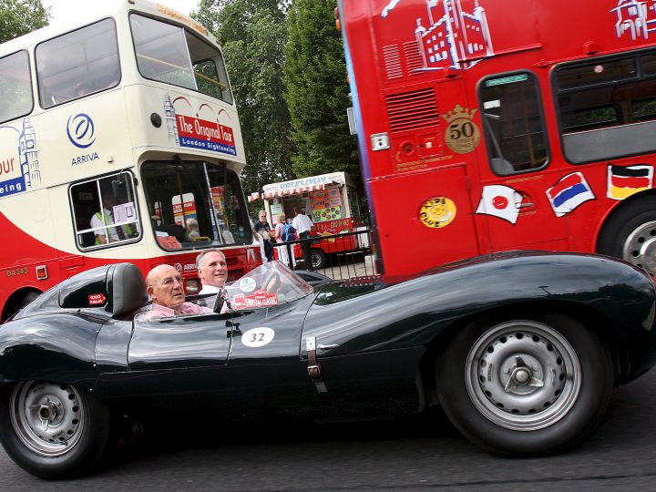 Former British racing driver Stirling Moss, 77, (foreground) drives a short nose D-Type Jaguar during a photo call to mark Jaguar XK cars 60th Anniversary in London, Britain, 25 June 2008. Jaguar celebrates 60 years of it's XK range of sports cars 07 August.  EPA/ANDY RAIN