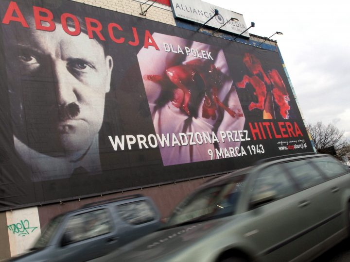 epa02064622 A photograph made available on 04 March 2010 and dated 03 March 2010 showing a poster of an anti abortion campaign using Adolf Hitler image, at one of the billboards in Poznan, Poland. Campaign of Fundation Pro - Right to Life used an image of Adolf Hitler next to covert with blood human fetus on its billboards.  EPA/ADAM CIERESZKO POLAND OUT