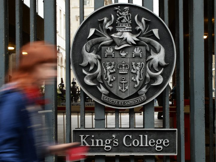 epa03894026 A student passes the main gates of King's College University in London, Britain, 03 October 2013. The university was established in 1829.  EPA/ANDY RAIN