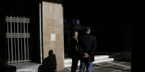 epa05020748 Two men stand outside the Bank of Greece in central Athens, Greece, 11 November 2015. The representatives of the institutions arrived in Athens to resume negotiations in order to reach an agreement by the end of the week. Non-performing loans, the protection of first residence from foreclosures, equal measures for the 23 pct VAT on private education, the settlement of 100 debt installments and generic drugs' prices are the pending issues that need to be resolved for the disbursement of the 2 billion tranche.  EPA/YANNIS KOLESIDIS