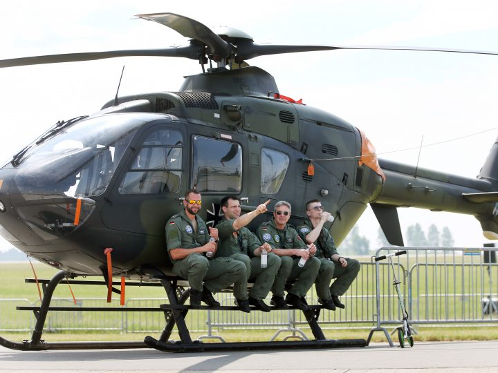 epa05338783 German 'Bundeswehr' pilots sit in the shadow of an EC 135 Eurocopter during the 2016 International Aerospace Exhibition (ILA), inSchoenefeld,Germany, 31 May 2016. Some 1,200 exhibitors from 40 countries are expected at the fairgrounds of the Berlin ExpoCenter Airport located on the southern airstrip of the future BER airport. The Berlin Air Show will open its gates from 01 to 04 June 2016. The conferences within this year's ILA 2016 will be focussed on 'technological Innovation'and 'Sustainability'.  EPA/WOLFGANG KUMM