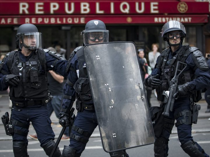 epa05541013 French riot police take up positions on Place de la Republique, during a demonstration against the new working law reform in Paris, France, 15 September 2016. French unions have called a national day of protest against the working law reform.  EPA/IAN LANGSDON
