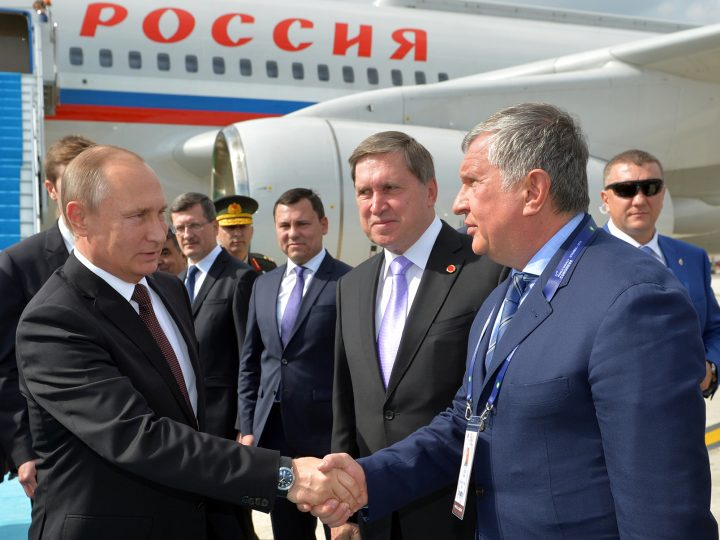 epa05579554 Russian President Vladimir Putin (L) shakes hands with head of Russia's top oil producer Rosneft, Igor Sechin (R) as he arrives at Ataturk airport in Istambul, Turkey. Putin is in Turkey to attend the 23rd World Energy Congress and during his visit he is expected to meet with Turkish President Recep Tayyip Erdogan to discuss possible energy and tade agreements.  EPA/ALEXEY DRUZHINYN /SPUTNIK/KREMLIN POOL