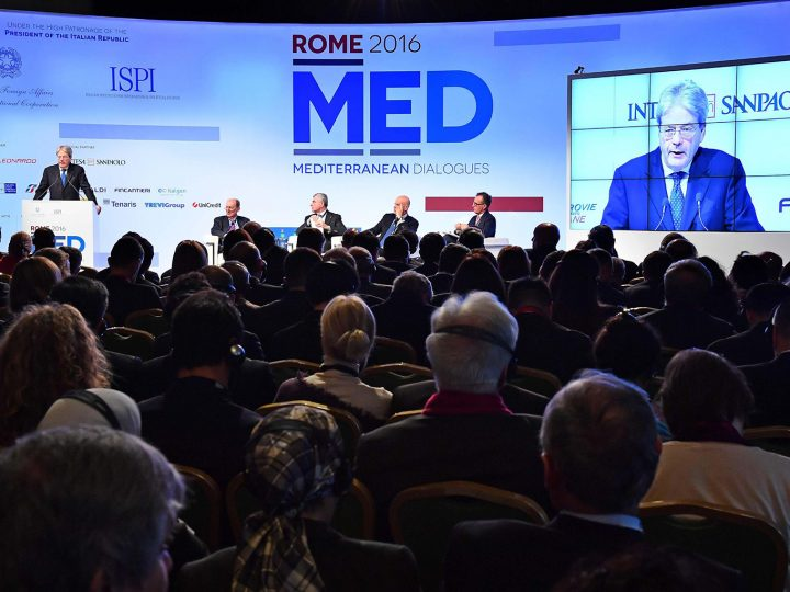 epa05655082 Italian Minister of Foreign Affairs Paolo Gentiloni (L and on screen R) delivers a speech during the second edition of the Med-Mediterranean dialogues in Rome, Italy, 01 December 2016. The Rome Med-Mediterranean dialogues are an annual high-level initiative organized by the Italian Ministry of Foreign Affairs and the Italian Institute for International Political Studies (ISPI).  EPA/ETTORE FERRARI