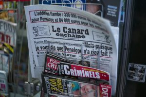 epa05764231 An issue of French satirical weekly newspaper Le Canard enchaine is on dsiplay among other newspapers in a kiosk in Paris, France, 01 February 2017. According to media reports former French Prime Minister and Les Republicains political party candidate for the 2017 presidential election Francois Fillon has come under pressure to explain the previous employment of his wife Penelope as parliamentary aide while he was a MP and to give details of the work she did. He has been hit by new claims that he also employed his children as 'parliamentary assistants'. French MPs are allowed to employ family members as aides.  EPA/YOAN VALAT