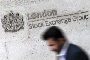 epa05818808 A man passes the writing of the London Stock Exchange Group (LSE) in London, Britain, 27 February 2017. The planned merger of Deutsche Boerse and London Stock Exchange (LSE) becomes uncertain after LSE announced on 26 February 2017 it would not be able to sell the trading platform MTS as requested by antitrust regulators of the European Union. EPA/ANDY RAIN