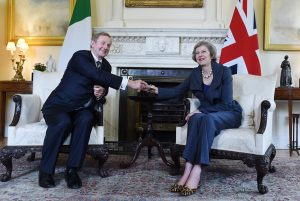 epa05441699 British Prime Minister Theresa May (R) shakes hands with Irish Prime Minister Enda Kenny (L) in the White Room during their meeting at 10 Downing Street in London, Britain, 26 July 2016. May met with Kenny for post brexit discussions, closely related to the border elements pertaining to Northern Ireland and The Republic of Ireland.  EPA/ANDY RAIN