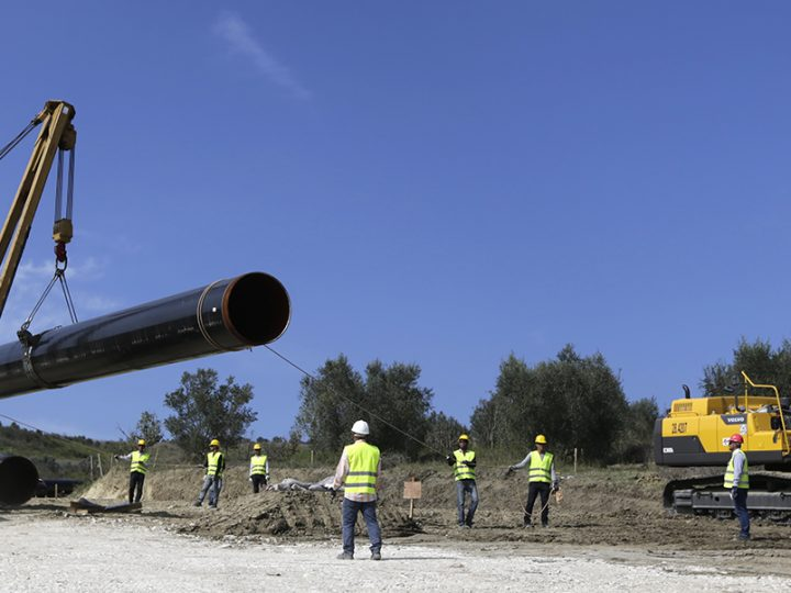epa05564886 A photograph made available 01 October 2016 showing workers starting to install the first pipe of the TAP project near Fier, Albania, 30 September 2016 putting the first of its 13,000 pipes for the 215 kilometer natural gas pipeline. TAP is a natural gas pipeline project which will start in Greece and crosses Albania and the Adriatic Sea to end in southern Italy bringing gas from the Caspian region to European markets.  EPA/ARMANDO BABANI