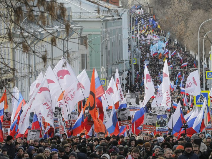 epa05816115 Russian people banners and flags during a memorial march for Boris Nemtsov to mark the second anniversary of his murder, in Moscow, Russia, 26 February 2017. Boris Nemtsov, a liberal opposition leader and sharp critic of Russian president Vladimir Putin, was killed on 27 February 2015 by a group of Chechen military servicemen. Five were arrested, one was killed during detention, and one of the organizers of the crime is still wanted.  EPA/MAXIM SHIPENKOV