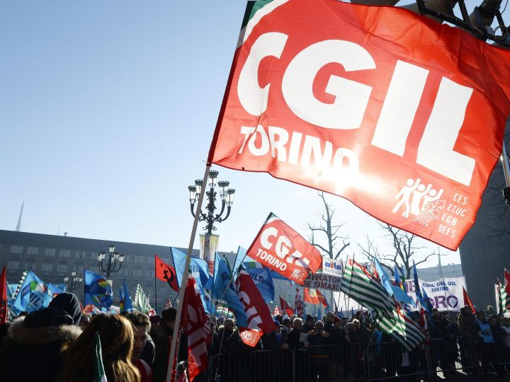 epa03990597 Members and supporters of Italy's three main labour unions CGIL, CISL and UIL take part in a protest march against the austerity policy of Italian Prime Minister Enrico Letta's government and in support of the right to education, in Turin, Italy, 14 December 2013. Protesters staged nationwide demonstrations against the government's 2014 draft budget law accused of failing to address record unemployment, including one in four young people out of work, or boost funds to a struggling education system.  EPA/ALESSANDRO DI MARCO