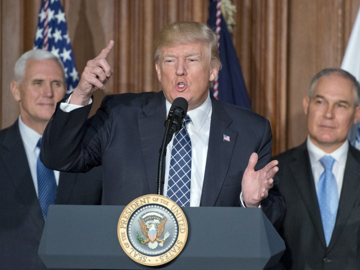 epa05875928 United States President Donald J. Trump makes remarks prior to signing an Energy Independence Executive Order at the Environmental Protection Agency (EPA) Headquarters in Washington, DC, USA, on 28 March 2017. The order reverses the Obama-era climate change policies.  US Vice President Mike Pence look on from left and EPA Administrator Scott Pruitt looks on from right.  EPA/Ron Sachs / POOL