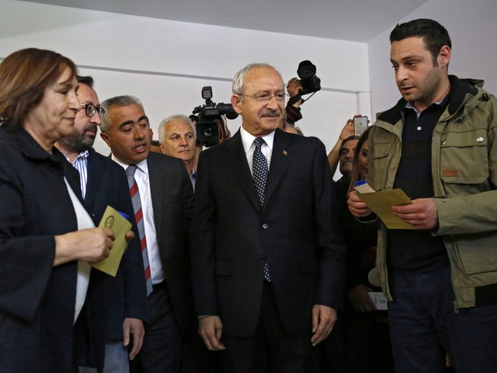 epa05911690 Kemal Kilicdaroglu (C), leader of main opposition party Republican People's Party (CHP), with supporters while casting his vote at a polling station for a referendum on the constitutional reform in Istanbul, Turkey, 16 April 2017. Kilicdaroglu said he will not accept a victory of the 'Yes' vote. Turkish state-run news agency Anadolu reports a narrow lead for the 'Yes' vote in the unofficial results. The proposed reform, passed by Turkish parliament on 21 January, would change the country's parliamentarian system of governance into a presidential one, which the opposition denounced as giving more power to Turkish President Erdogan.  EPA/TUMAY BERKIN