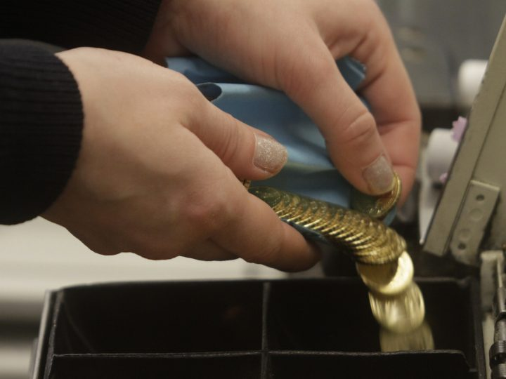 epa04544135 A cashier counts new Lithuanian euro coins at a shop in Vilnius, Lithuania, 01 January 2015. Lithuania became the 19th country to join the eurozone, 15 years after Europe first introduced the single currency. Lithuania is the last Baltic country to adopt the euro, after Estonia did so in 2011 and Latvia followed suit in January 2014. Officials have argued that the move will also help bolster national security. Lithuania and its eastern European neighbours have said they feel threatened by Russia's actions in Ukraine. Russia is Lithuania's largest trading partner.  EPA/VALDA KALNINA