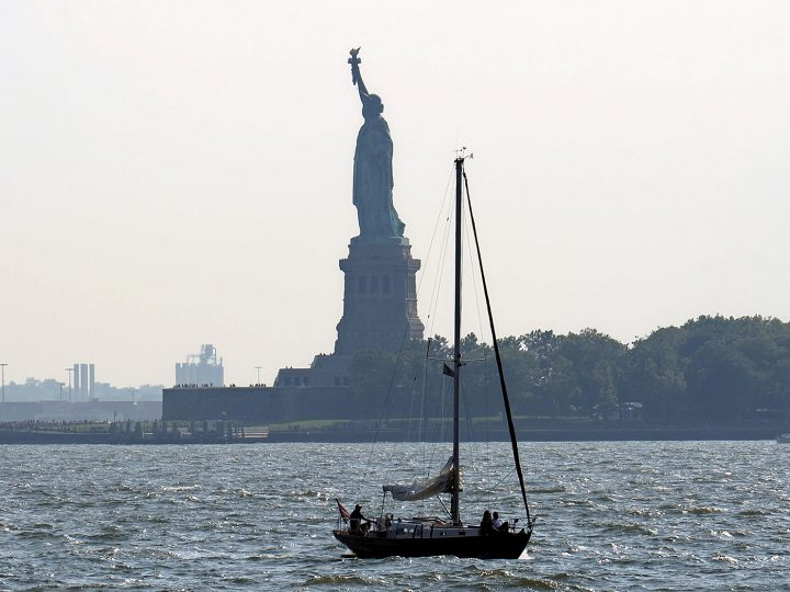 epa04904694 A sailboat navigates the Hudson River as the Statue of Liberty looms in the background in the New York Harbor in New York City, New York, USA, 29 August 2015.  EPA/JOHN G. MABANGLO