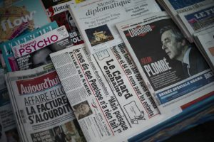 epa05764230 An issue of French satirical weekly newspaper Le Canard enchaine is on dsiplay among other newspapers in a kiosk in Paris, France, 01 February 2017. According to media reports former French Prime Minister and Les Republicains political party candidate for the 2017 presidential election Francois Fillon has come under pressure to explain the previous employment of his wife Penelope as parliamentary aide while he was a MP and to give details of the work she did. He has been hit by new claims that he also employed his children as 'parliamentary assistants'. French MPs are allowed to employ family members as aides.  EPA/YOAN VALAT