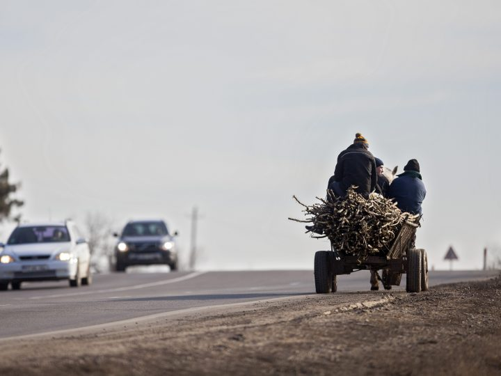epa05830046 A horse cart carrying wood rides on M2 national road, near Peresecina village, near Chisinau, Moldova, 04 March 2017. The minimum salary in the Moldova Republic is about 93 Euro, with the minimal retirement pension being around 38 Euro, it was calculated by official sources for the 2016.  EPA/DUMITRU DORU