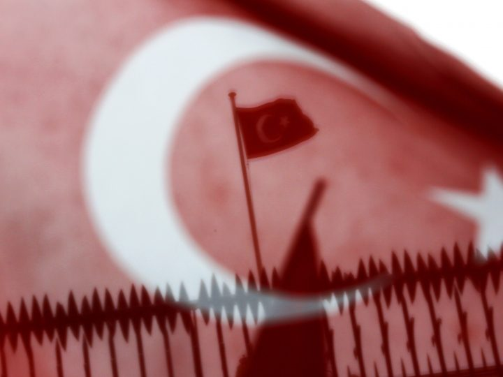 epa05843833 A Turkish flag flies on the roof of  the Dutch Consulate during a protest in Istanbul, Turkey 12 March 2017. Turkish Family Minister Fatma Betul Sayan Kaya was barred by police from entering the Turkish consulate in Rotterdam on 11 March, after the Dutch government had denied landing rights to Turkish Foreign Minister Cavusoglu who planned a speech at the consul's residence in Rotterdam. The incidents have led to a diplomatic row between the two countries, and protests by Turkish citizens in the Netherlands as well as in Turkey.  EPA/CEM TURKEL