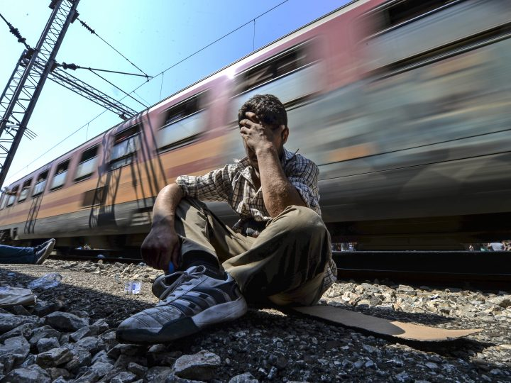 epa05853852 (FILE) - A file picture dated 13 August 2015 shows an exhausted and frustated migrant holding his head after he missed to get a place on a train heading to the Serbian border at the train station in Gevgelija, The Former Yugoslav Republic of Macedonia (FYROM). The summer of 2015 put the cooperation between EU countries to a test when more than a million refugees entered Europe fleeing from wars and poverty. The 60th anniversary of the signing of the Treaty of Rome is marked on 25 March 2017. The treaty was signed on 25 March 1957 by Belgium, France, Italy, Luxembourg, the Netherlands and West Germany to form the European Economic Community (ECC). It continues to be one of the most important ones in the history of the European Union (EU).  EPA/GEORGI LICOVSKI