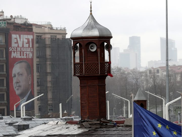 epa05854228 A giant poster of Turkish President Recep Tayyip Erdogan (L), minaret of Taksim Mosque (C), European Union (EU) flag (R) at the Taksim Square in Istanbul, Turkey, 17 March 2017. Turkish parliament on 21 January approved a reform of the constitution to change the country's parliamentarian system of governance into a presidential one, which the opposition denounced as giving more power to Turkish president Recep Tayyip Erdogan. A referendum on the amendments is expected to be held in April.  EPA/SEDAT SUNA