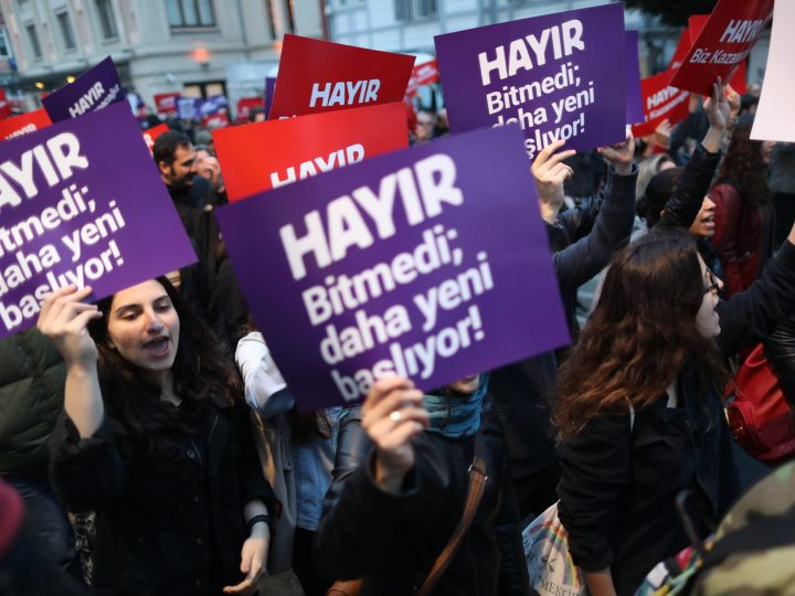 epa05912612 Protesters shout slogans and hold placards reading 'NO we will win' during a rally against the referendum results in Istanbul, Turkey, 17 April 2017. Media reports Turkish President Erdogan won a narrow lead of the 'Yes' vote in unofficial results, 17 April 2017. The proposed reform, passed by Turkish parliament on 21 January, would change the country's parliamentarian system of governance into a presidential one, which the opposition denounced as giving more power to Turkish President Erdogan.  EPA/TOLGA BOZOGLU