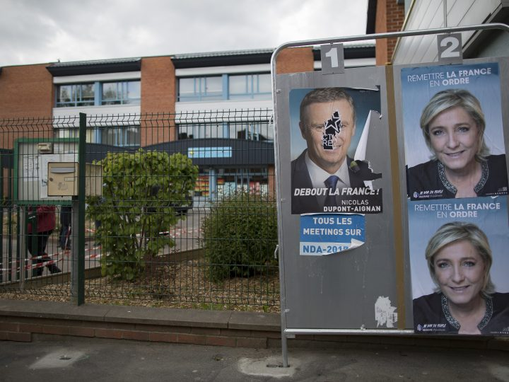 epa05921942 Posters of French presidential election candidate for the far-right Front National (FN) party, Marine Le Pen, adorn billboards outside the polling station in which she is due to cast her ballot, on the eve of election day, in Henin-Beaumont, Northern France, 22 April 2017. France holds the first round of the 2017 presidential elections on 23 April 2017.  EPA/IAN LANGSDON
