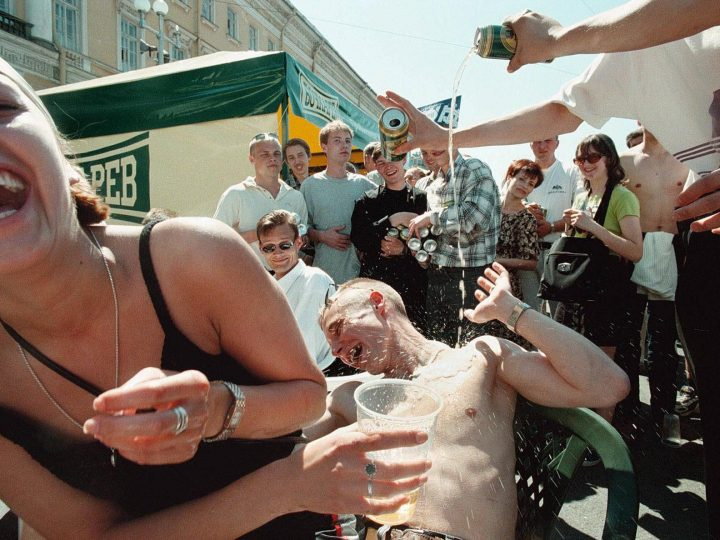 SPB01-19990613-ST.PETERSBURG, RUSSIAN FEDERATION: Young people pour beer over a man during a beer festival in St.Petersburg on Sunday 13 June 1999. Thousands of city-dwellers gathered in the downtown St.Petersburg to take part in the festival.   EPA PHOTO   EPA/ANATOLY MALTSEV