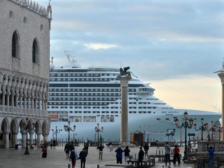epa05427779 (FILE) The file picture dated 21 September 2013 shows luxury cruise liner 'MSC Divina' passing in front of San Marco Square in Venice, Italy. Media reports on 16 July 2016, that the UNESCO World Heritage Committee has threatened to put Venice on their list of endangered heritage sites on 14 July 2016, if authorities fail to ban big cruise liner from the lagoon by 2017. The 40th World Heritage Committee meets in Istanbul from 10 to 20 July 2016.  EPA/ANDREA MEROLA