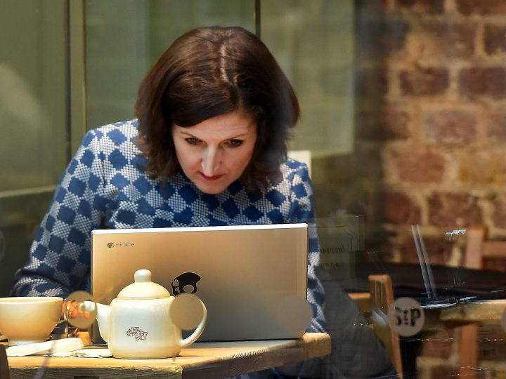 epa05101506 A customer uses the internet at a coffee shop in London, Britain, 14 January 2016. Coffee shops with public wifi networks may be obliged to store internet data for up to a year under new snoopers charter laws, the UK government has said.  EPA/ANDY RAIN