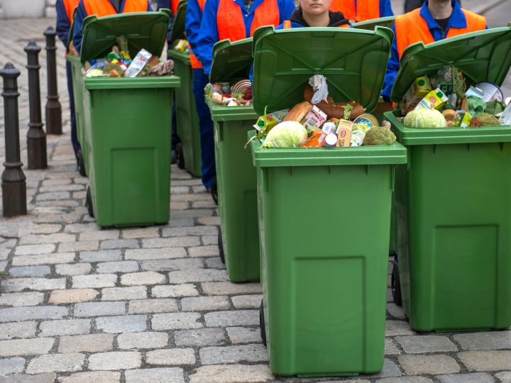 epa05255143 Greenpeace activists move garbage cans filled with food to protest against food waste in front of the Austrian parliament building in Vienna, Austria, on 12 April 2016. Greenpeace claims that every nine seconds about one ton of food is dumped to the rubbish bin.  EPA/CHRISTIAN BRUNA