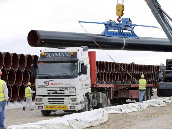 epa05530869 Workers unload pipes for the Trans-Adriatic Pipeline (TAP), in Spitalle, Albania, 08 September 2016. TAP is a natural gas pipeline project which will start in Greece and cross Albania and the Adriatic Sea to end in southern Italy bringing gas from the Caspian region to European markets.  EPA/ARMANDO BABANI