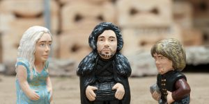 epa05617667 Two traditional Christmas little sculptures called 'caganers' (lit. defecators) picturing characters of Game of Thrones TV series Daenerys Targaryen (L), John Snow (C) and Tyrion Lannister (R) are launched by the brand caganer.com in the town of Torroella de Montgri, Catalonia, northeastern Spain, 04 November 2016. The 'caganer' is a traditional figure in Catalonian nativity scenes.  EPA/ROBIN TOWNSEND