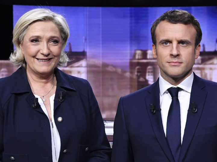 epa05942562 French presidential election candidate for the far-right Front National (FN) party, Marine Le Pen (L) and French presidential election candidate for the En Marche ! movement, Emmanuel Macron pose prior to the start of a live brodcast face-to-face televised debate in television studios of French public national television channel France 2, and French private channel TF1 in La Plaine-Saint-Denis, north of Paris, France, on 03 May 2017 as part of the second round election campaign. Pro-EU centrist Emmanuel Macron and far-right leader Marine Le Pen face off in a final televised debate on 03 May that will showcase their starkly different visions of France's future ahead of this weekend's presidential election run-off.  EPA/ERIC FEFERBERG / POOL MAXPPP OUT