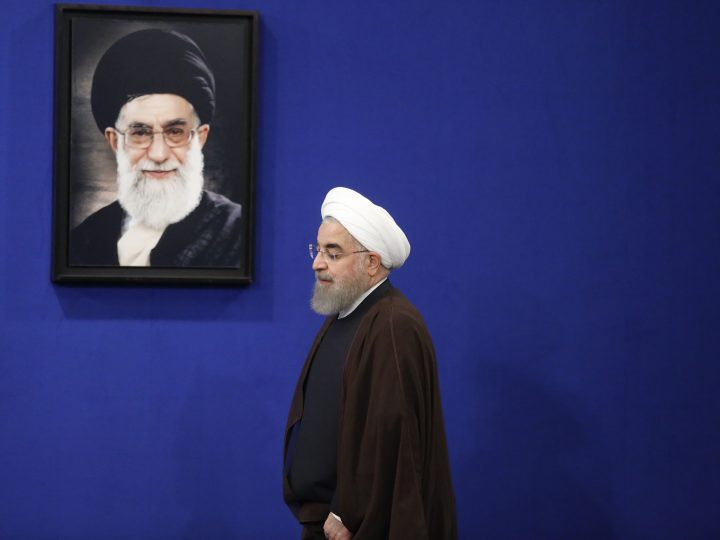 epaselect epa05977222 Newly re-elected Iranian President Hassan Rouhani walks past a picture of Iranian Supreme leader Ayatollah Ali Khamenei, on arriving to deliver a televised speech on his presidential election victory, in Tehran, Iran, 20 May 2017. Rouhani has won the Islamic republic's presidential election and will serve for a second term.  EPA/STRINGER