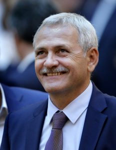 epa06040769 Liviu Dragnea (C), the president of the Romanian Parliament's Deputies Chamber, also the leader of the main ruling party PSD (Social Democracy Party) smiles after the no-confidence vote against Sorin Grindeanu cabinet ended, at Parlament Palace in Bucharest, Romania, 21 June 2017. Grindeanu cabinet was ousted by a no-confidence vote in which 241 lawmakers from a total of 251 voted against his government. The ruling party PSD (Social Democracy Party) withdrew political support for Grindeanu governemnt on 14 June, after six months activity. PSD leader Liviu Dragnea stated that Sorin Grindeanu and his team had failed to respect the party's governing program, and he does not have the party's support. Grindeanu defended his cabinet announcing he will not resign unless PSD party leader Liviu Dragnea resign. EPA/ROBERT GHEMENT