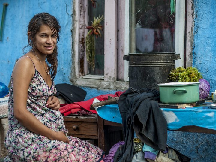epa03863806 (15/16) A pregnant young woman sits in the courtyard of her hut in a slum inhabited by a Roma community in the Craica neighbourhood of Baia Mare, north-western Romania, 05 September 2013. This year the local government planned to demolish shanties of the Craica slum and move hundreds of residents to a new housing estate of 500 light structure, modular homes to be set up in the outskirts of Baia Mare.  EPA/ZSOLT CZEGLEDI HUNGARY OUT - PLEASE REFER TO ADVISORY NOTICE  (epa03863791) FOR FULL FEATURE TEXT