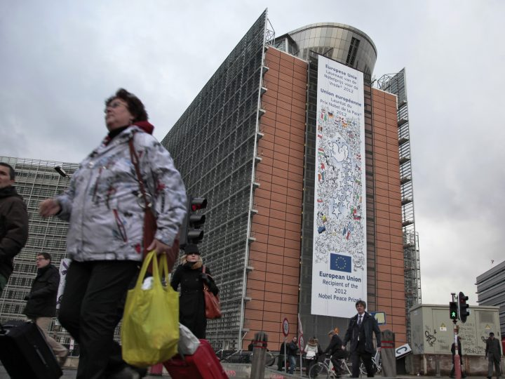 epa03920492 (FILE) A file photo dated 10 December 2012 showing a giant placard announcing the European Union as Nobel Peace Prize 2012 laureate on the facade of the European comission building in Brussels, Belgium. The president of the European Union's executive warned on 23 October 2013 that it is about to run out of money, and called on the bloc's governments and parliament to bury the hatchet over planned budget changes. He has told European Parliament plenary in Strasbourg that the commission will no longer be able to make payments from November if it is not provided with an extra 2.7 billion euros (3.7 billion dollars). The shortfall is due to lower-than-expected revenue from EU import duties.  EPA/OLIVIER HOSLET