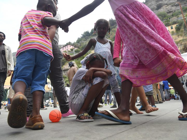 epa05415533 Migrant children play on a sports field on the premises of the Sant'Antonio Parish in Ventimiglia, Italy, 08 July 2016. A larger group of migrants is accomodated on the church's premisis with many reportedly waiting and hoping to cross the nearby border to France.  EPA/LUCA ZENNARO