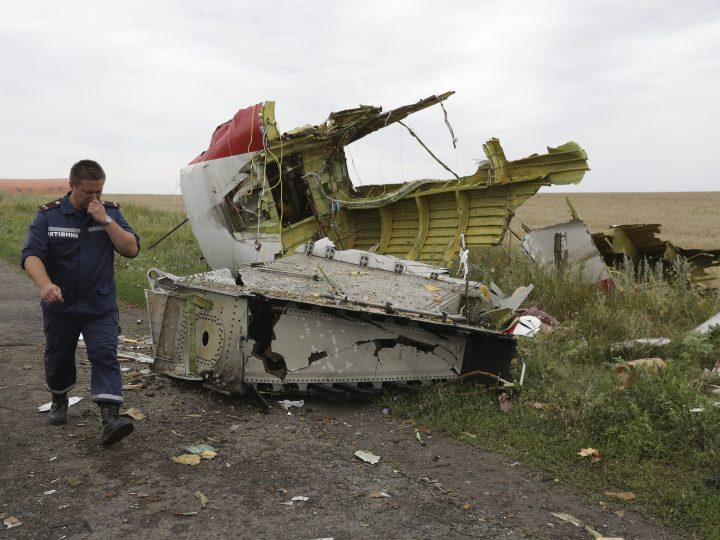 epa05560310 (FILE) A file photo dated 18 July 2014 showing a Ukrainian rescue worker passing wreckage of the Boeing 777, Malaysia Arilines flight MH17, which crashed during flying over the eastern Ukraine region near Donetsk, Ukraine. Reports on 28 September 2016 state the group of international prosecutors had come to a conclusion a BUK missile fired from rebel territory in eastern Ukraine hit the plane as it was flying from Amsterdam to Kuala Lumpur. All 298 people aboard the plane died.  EPA/ANASTASIA VLASOVA