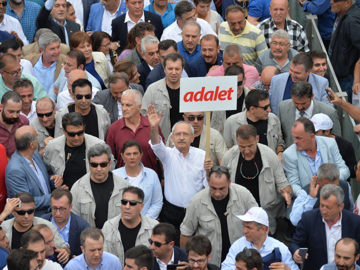 epa06029188 Turkey's main opposition Republican People's Party (CHP) leader Kemal Kilicdaroglu (C) holds a placard reading 'Justice', during a march from Ankara to Istanbul to call attention to arrests by Turkish courts, in Ankara, Turkey, 15 June 2017. The march from Ankara to Istanbul called the 'justice march', is aimed to protesting against the arrest of party deputy Enis Berberoglu.  EPA/STR