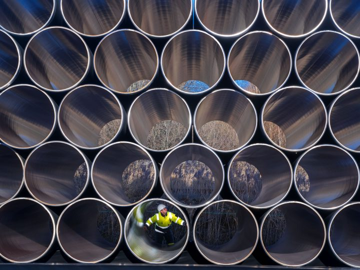 epaselect epa05662430 A worker inspects stacks of pipes weighing several tons each which will be used for the construction of the Nord Stream gas pipeline in the Sassnitz-Mukran harbour in northeastern Germany, 06 December 2016. The first sections of the 1,200 kilometer pipeline were delivered in late October 2016. Around 2,000 of a total 90,000 steal pipe components are currently being stored on the island of Ruegen. According to the Gazprom subsidiary Nord Stream 2 AG, the assembly works will begin in mid-2017. So far the political controversial pipeline, which will have a total capacity of some 55 billion cubic meters, has not recieved building permission.  EPA/JENS BUETTNER