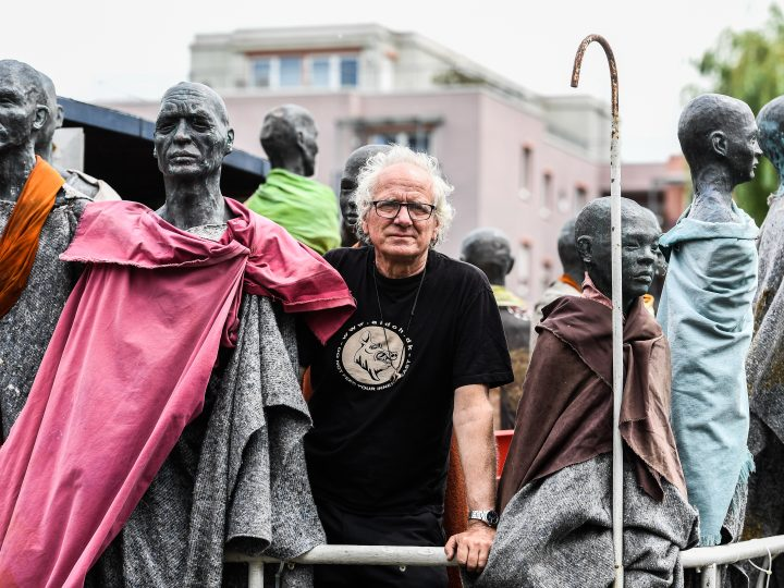 epa06018791 Danish artist Jens Galschiot poses with his art work called 'The Refugee ship'  at the 'Documenta 14' exhibition in Kassel, Germany, 09 June 2017. The ship 80 refugees sculptures draw a parallel to the Mediterranean' s desperates refugees reminding of human responsibility. Documenta is a contemporary art exhibition, which takes place every five years. The 14th edition takes places in Athens from 08 April to 16 July and in Kassel from 10 June to 17 September 2017.  EPA/FILIP SINGER