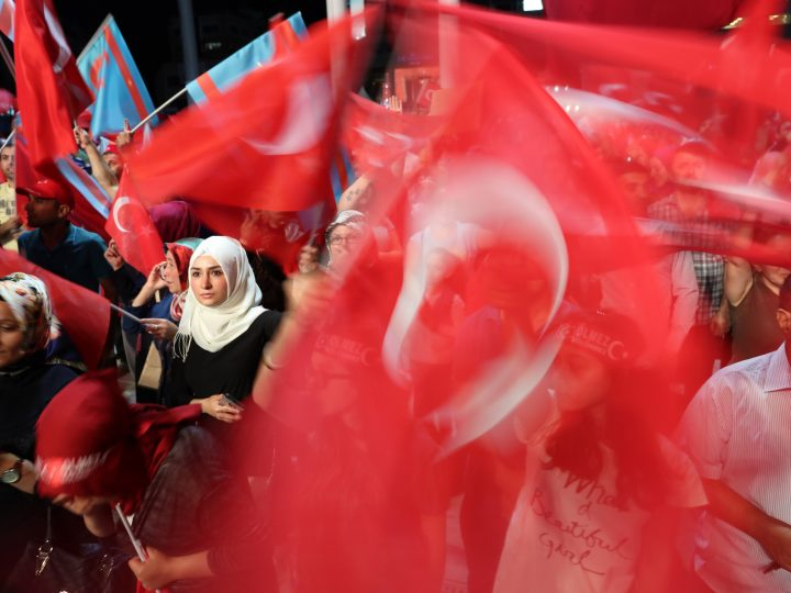 epa06067062 (FILE) - Supporters of Turkish President Recep Tayyip Erdogan shout slogans and hold flags during a demonstration against the 15 July failed coup attempt, at Taksim Square, in Istanbul, Turkey, 20 July 2016 (reissued 05 July 2017). 15 July 2017 marks the first anniversary of a failed coup attempt in Turkey. Turkish military factions on 15 July 2016 attempted a coup d'etat, for which Turkish President Recep Tayyip Erdogan was quick to blame US-based Turkish cleric Fetullah Gulen and his movement to allegedly have masterminded the attempt. Some 50,000 workers were dismissed, some 8,000 people arrested, and scores of news outlets shut down by the government in the aftermath of the failed coup. Turkey has remained under a state of emergency since, and a constitutional referendum was held and won with a narrow majority to convert the country's parliamentary system into an executive presidency.  EPA/TOLGA BOZOGLU